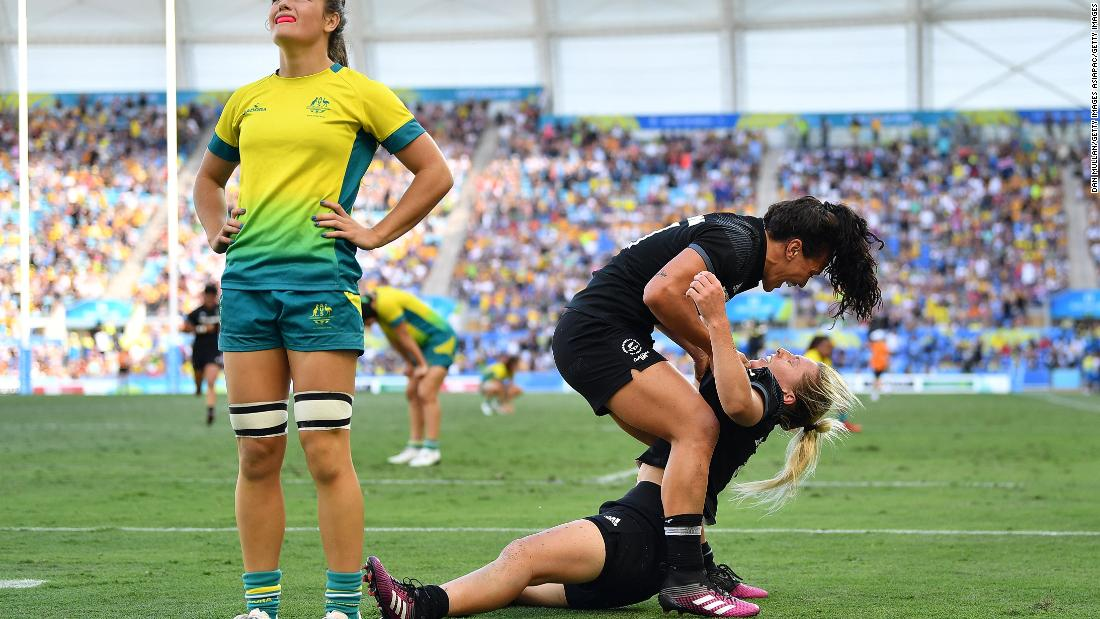 Brazier is congratulated by teammate Portia Woodman after her try secured gold for the Kiwis.