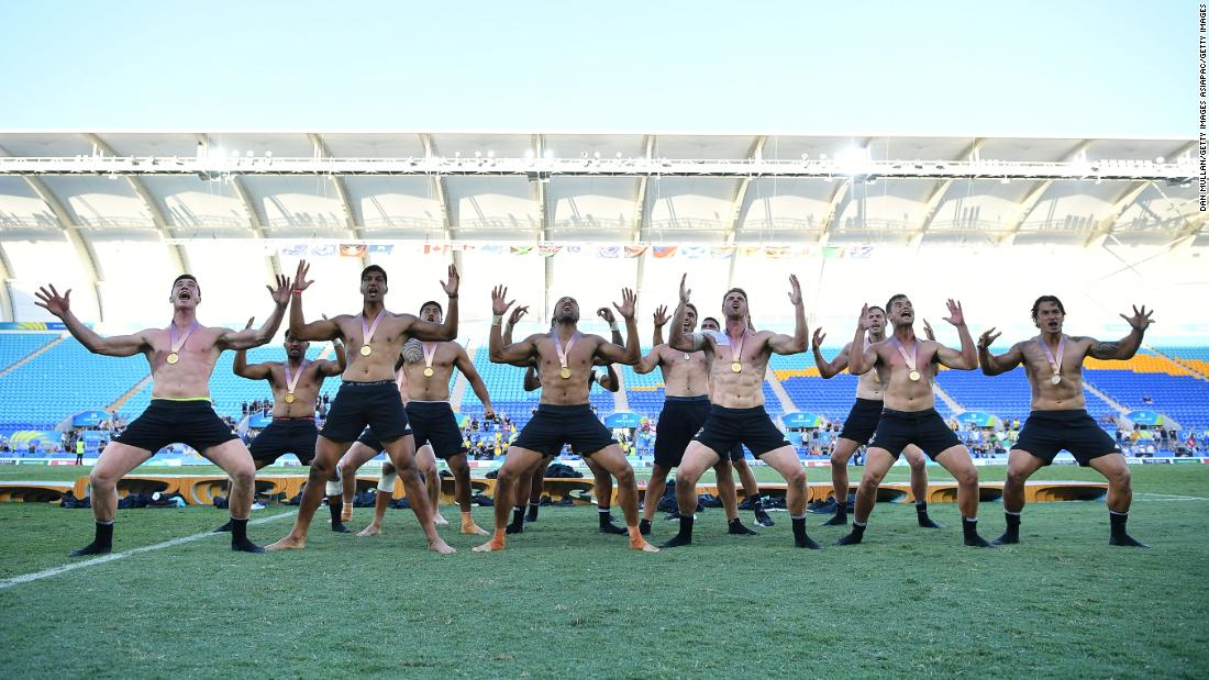 Gold medalists New Zealand perform a haka or traditional Maori war dance.