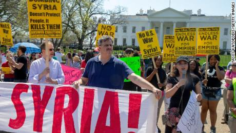 WASHINGTON, DC - APRIL 14: Protesters gather outside the White House and speak out against the latest developments of the strike in Syria on April 14, 2018 in Washington, DC. Yesterday the United States and European allies Britain and France launched airstrikes in Syria as punishment for Syrian President Bashar al-Assad's suspected role in last week's chemical weapons attacks that killed upwards of 40 people. (Photo by Tasos Katopodis/Getty Images)
