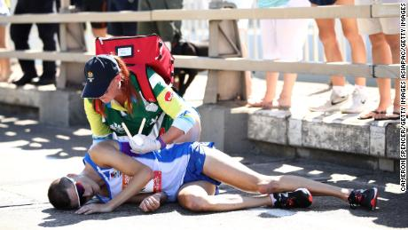 Callum Hawkins of Scotland is given assistance as he collapses in the Men's marathon on day 11 of the Gold Coast 2018 Commonwealth Games at Southport Broadwater Parklands on April 15, 2018 on the Gold Coast, Australia.