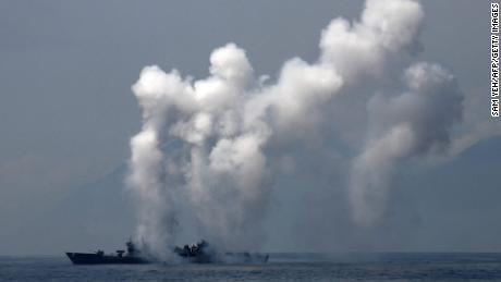 A frigate launches chaff and flare during a drill at the sea near eastern Taiwan on April 13.
