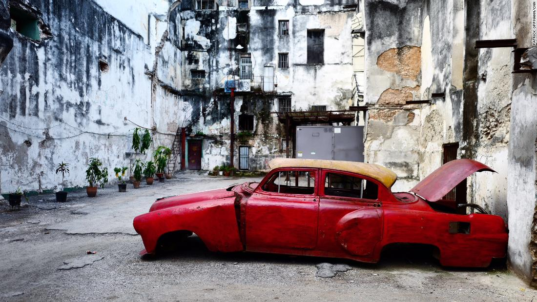 An American car from the 1950s rots in the run-down neighborhood of Centro Habana. Transportation and housing are in short supply in Cuba. Most Cubans still work for the state and barely earn enough to live on, much less afford a luxury item like a car or a better place to live. Cuban officials blame the US trade embargo for Cuba's economic woes. Critics say government inefficiency and poor planning have kept wages low.