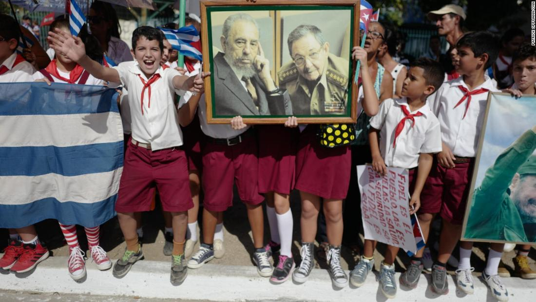 Cuban students greet Fidel Castro's funeral caravan in 2016 as it traveled through Holguín, Cuba, near where Castro was born. After Castro died at the age of 90, his ashes were driven through the island, retracing the route he took as a young guerrilla leader.  Upon taking power, Castro promised democratic elections but instead stayed in office for nearly 50 years.