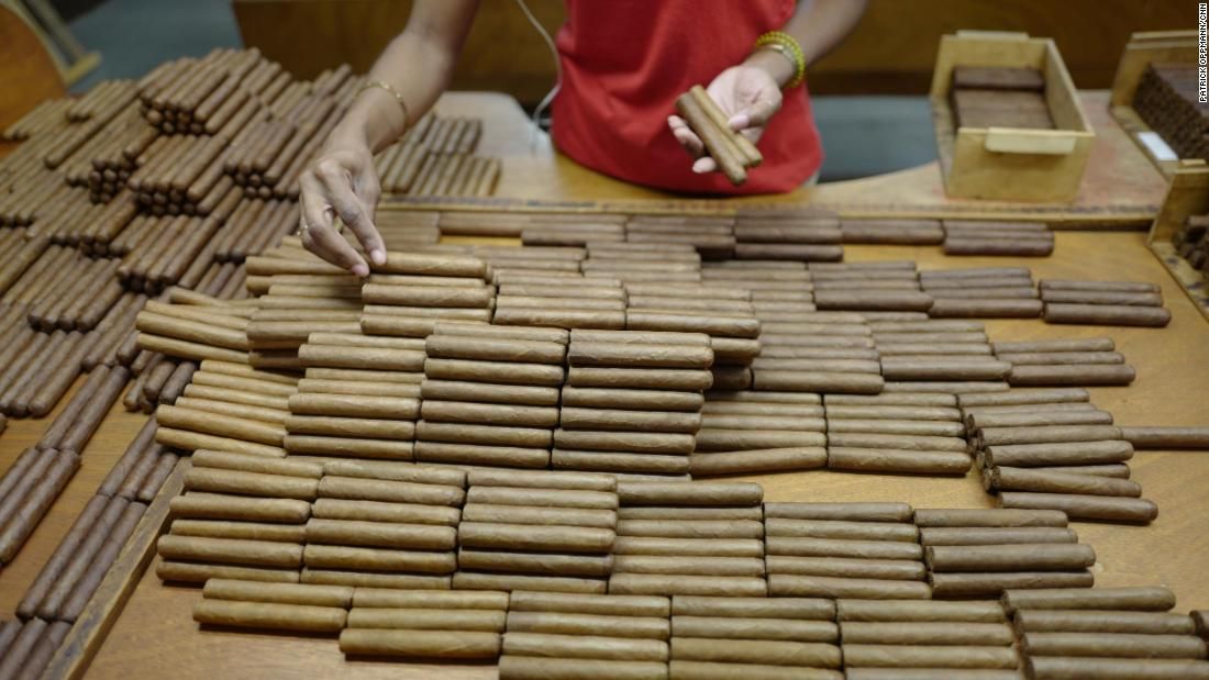 A worker at the Partagas factory in Havana sorts some of Cuba's famed cigars to ensure that each box contains tobacco of the same color. Cuban cigars are still rolled by hand as they have been for generations. For years, Cuban cigars were banned in the US, but as part of his shift in policy toward Cuba, President Obama changed the law to allow US citizens to bring habanos back from trips abroad. The US trade embargo still prohibits the sale of Cuban cigars in the US.