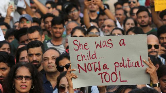 A participant holds a placard during a protest against recent incidents of rape in the country, in Mumbai, India, Sunday, April 15, 2018.