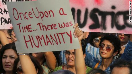 Indian film producer Kiran Rao, right, holds a placard during a protest against recent incidents of rape in the country, in Mumbai, India, Sunday, April 15, 2018. Violent crimes against women have been on the rise in India despite tough laws enacted in 2013. (AP Photo/Rafiq Maqbool)