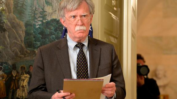 National Security Advisor John Bolton listens to remarks by U.S. President Donald Trump as he speaks to the nation, announcing military action against Syria for the recent apparent gas attack on its civilians, at the White House, on April 13, 2018, in Washington, DC. (Mike Theiler - Pool/Getty Images)