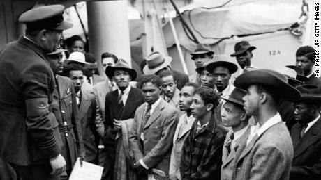 Jamaican immigrants welcomed by RAF officials from the Colonial Office after the ex-troopship  HMT 'Empire Windrush' landed them at Tilbury.   (Photo by PA Images via Getty Images)