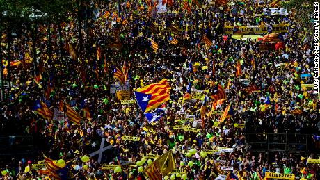 "TOPSHOT - People march during a demonstration to support Catalan pro-independence jailed leaders and politicians and called by 'Espai Democracia i Convivencia' platform that groups separatist collectives and unions in Barcelona on April 15, 2018.  Thousands of people marched in Barcelona today to protest the jailing of nine Catalan separatist leaders facing trial on ""rebellion"" charges. Many chanted ""Freedom for the political prisoners"" as they massed on the Parallel Avenue, one of the city's main streets, wearing yellow scarves, sweaters or jackets -- the colour chosen to show solidarity with the jailed leaders.  / AFP PHOTO / LLUIS GENE        (Photo credit should read LLUIS GENE/AFP/Getty Images)"