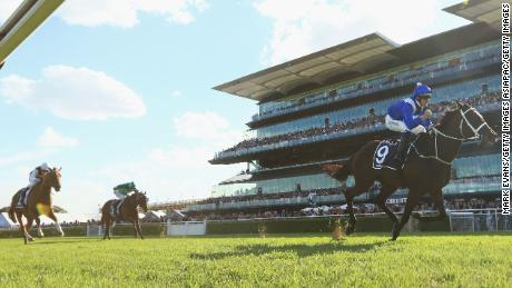 Winx and her jockey, Hugh Bowman, on the way to a historic win in the Queen Elizabeth Stakes in Sydney's Royal Randwick Racecourse on Saturday.