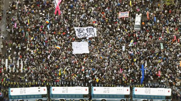 Crowds gather Saturday outside Japan's Diet to demand Prime Minister Shinzo Abe's resignation.