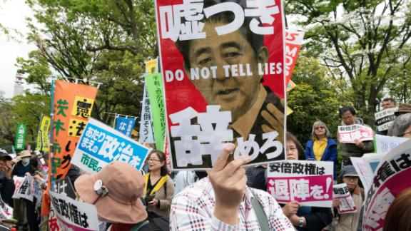 A protester holds a placard during a demonstration against Japan