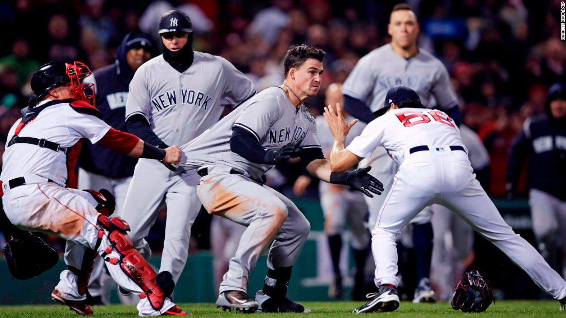 "New York Yankees' Tyler Austin, center, is held back by Red Sox catcher Christian Vazquez as Austin rushes Boston Red Sox relief pitcher Joe Kelly, right, after <a href=""http://bleacherreport.com/articles/2770075-yankees-vs-red-sox-erupts-in-brawl-after-joe-kelly-hits-tyler-austin-with-pitch"" target=""_blank"">being hit by a pitch</a> during a baseball game at Fenway Park on Wednesday, April 11. The hit led to a <a href=""http://bleacherreport.com/articles/2770229-joe-kelly-suspended-5-games-tyler-austin-6-for-red-sox-vs-yankees-brawl"" target=""_blank"">bench-clearing brawl</a> and left Kelly and Austin suspended for five and six games, respectively."