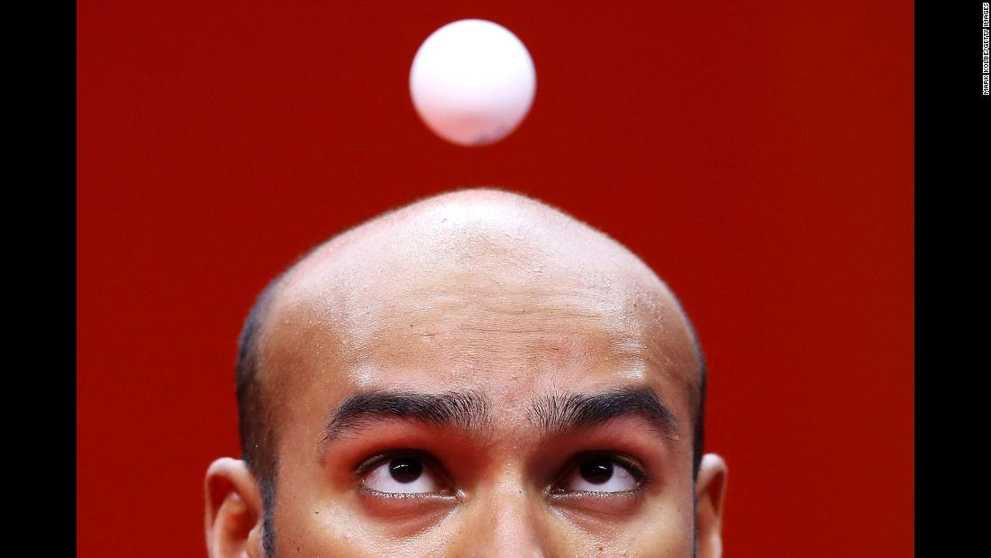 Rhikesh Taucoory of Mauritius eyes the ball as he serves during his men's singles table tennis match against Craig Howieson of Scotland on day six of the Commonwealth Games on the Gold Coast in Australia on Tuesday, April 10.