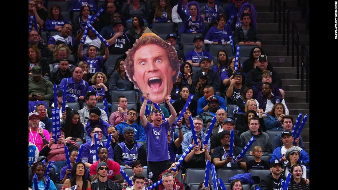 "A Sacramento Kings fan holds up a cardboard cutout of Will Ferrell's character from the movie ""Elf"" during a Houston Rockets free throw on Wednesday, April 11, in Sacramento, California."