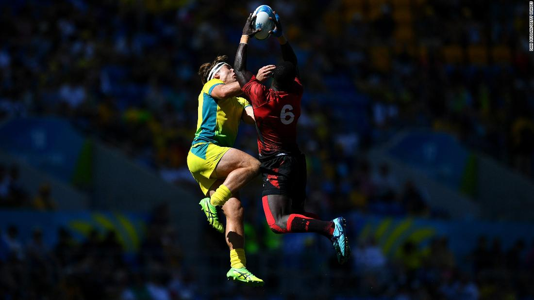 Charlie Taylor of Australia, left, vies for the high ball with Jeff Oluoch of Kenya during the Rugby Sevens men's placing 5-8th match on day 11 of the Commonwealth Games on the Gold Coast in Australia on Sunday, April 15.