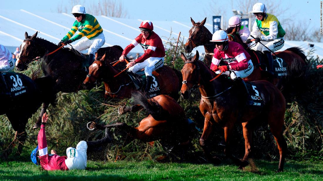 Jockey Rachael Blackmore is unseated from Alpha Des Obeaux during the Grand National horse race at Aintree Racecourse in Liverpool, England, on Saturday, April 14. Both horse and rider were in good condition after the fall.