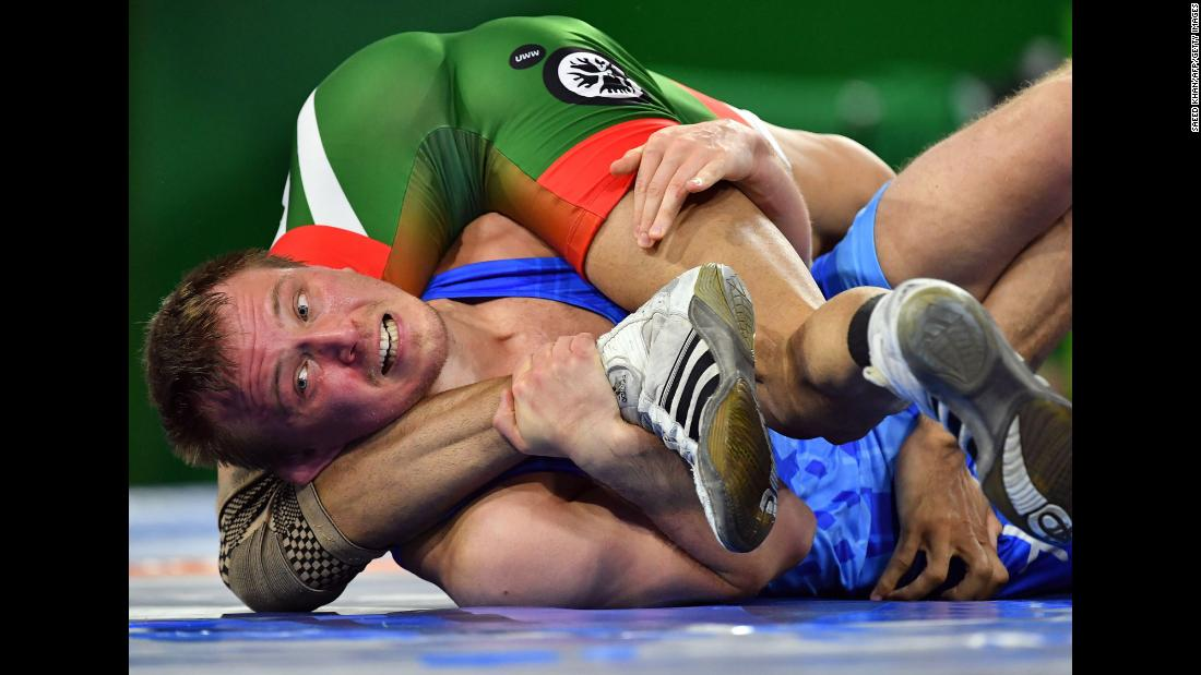 Scotland's Oleg Gladkov, in blue, wrestles with Pakistan's Muhammad Asad Butt during the men's freestyle 74 kilogram wrestling match at the Commonwealth Games on the Gold Coast in Australia on Thursday, April 12.