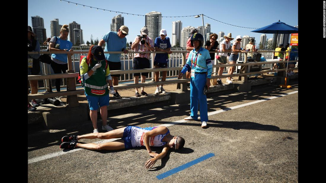 Callum Hawkins of Scotland collapses during the men's marathon on day 11 of the Commonwealth Games on the Gold Coast in Australia on Sunday, April 15.