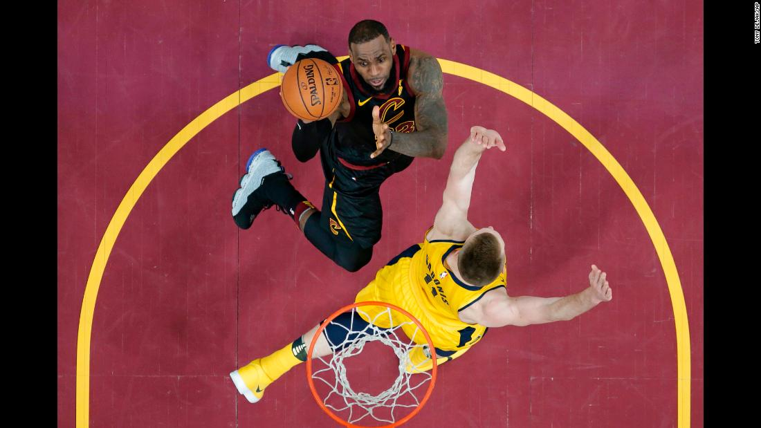 Cleveland Cavaliers' LeBron James drives against Indiana Pacers' Domantas Sabonis in the first half of Game 1 of an NBA basketball first-round playoff series on Sunday, April 15, in Cleveland.