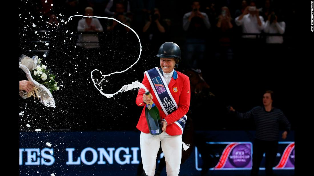 "Elizabeth ""Beezie"" Madden of USA celebrates during the trophy ceremony after winning the FEI World Cup Jumping Final on Saturday, April 14, in Paris."