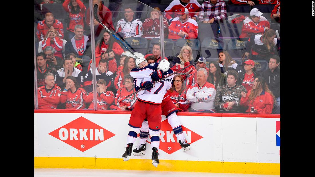 Columbus Blue Jackets left wing Matt Calvert, 11, celebrates his game-winning goal with center Brandon Dubinsky, 17, in overtime in game 2 of an NHL first-round hockey playoff series against the Washington Capitals on Sunday, April 15, in Washington. The Blue Jackets won 5-4 in overtime.