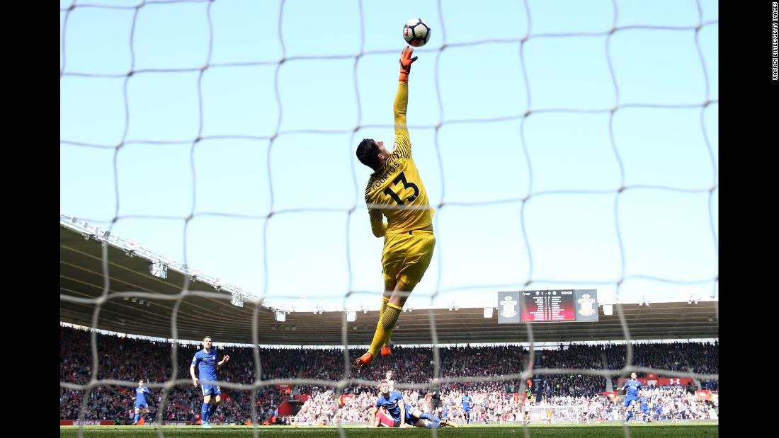 Thibaut Courtois of Chelsea jumps to makes a save during the Premier League match against Southampton on Saturday, April 14, in Southampton, England.