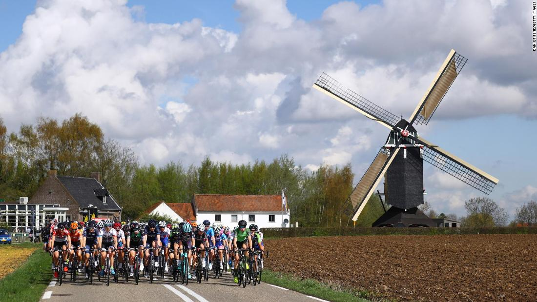 "The peloton passes by a windmill during the fifth Amstel Gold Race on Sunday, April 15, in Berg En Terblijt, Netherlands. <a href=""https://www.cnn.com/2018/04/09/sport/gallery/what-a-shot-sports-0410/index.html"" target=""_blank"">See 25 amazing sports photos from last week</a>"