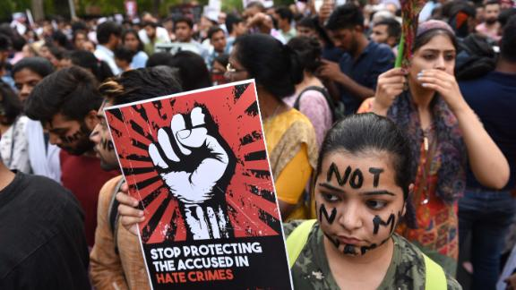 NEW DELHI, INDIA - APRIL 15: People take part in 'Not In My Name' protest against the Kathua and Unnao rape cases, at Parliament Street, on April 15, 2018 in New Delhi, India. An 8-year-old nomad girl was raped and murdered in Jammu's Kathua in January after she was kidnapped and sedated. In the other case, a 17-year-old girl alleged rape by BJP legislator Kuldeep Sigh Sengar and his brother Atul Singh in Uttar Pradesh. The girl's father died earlier this week after he was allegedly beaten by the men of the rape accused. (Photo by Arvind Yadav/Hindustan Times via Getty Images)