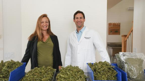 Dr. Kalev Freeman, an emergency room physician, and Monique McHenry, a botanist, stand with hemp samples. They helped create classes focused on marijuana at the University of Vermont