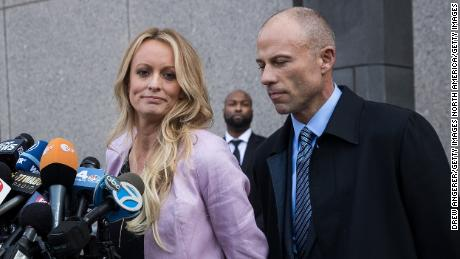 NEW YORK, NY - APRIL 16: (L to R) Adult film actress Stormy Daniels (Stephanie Clifford) and Michael Avenatti, attorney for Stormy Daniels, speak to the media as they exit the United States District Court Southern District of New York for a hearing related to Michael Cohen, President Trump's longtime personal attorney and confidante, April 16, 2018 in New York City.  Cohen and lawyers representing President Trump are asking the court to block Justice Department officials from reading documents and materials related to Cohen's relationship with President Trump that they believe should be protected by attorney-client privilege. Officials with the FBI, armed with a search warrant, raided Cohen's office and two private residences last week.  (Photo by Drew Angerer/Getty Images)