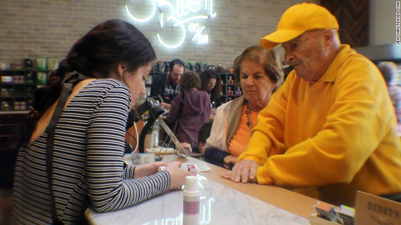 John and Anne Lustig learn about cannabis lotions at the dispensary.
