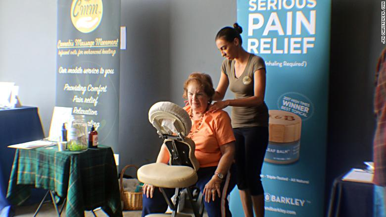 Anne Lustig gets a massage with cannabis oil.