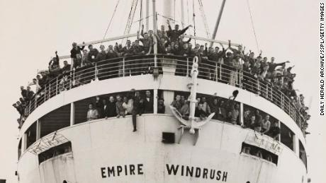 UNITED KINGDOM - JUNE 02:  The ?Windrush? arrives from Jamaica, 21 June 1948. A photograph of SS Empire Windrush docking at Tilbury, having sailed from Australia via Jamaica, with crowds of waving passengers, taken by Jones for the Daily Herald newspaper. During the war, thousands of men and women from the Carribbean were recruited to serve in the armed forces and aid the labour shortage in Britain. When Windrush stopped in Jamaica to pick up servicemen, many others, having seen the 'Daily Gleaner' newspaper advertising the journey for £28.10, decided to make the journey as well. Windrush left Kingston, Jamaica on 24 May with nearly 500 passengers. The immigrants were not allowed ashore until the next day, after they had gone through the customary check-up.  (Photo by Daily Herald Archive/SSPL/Getty Images)