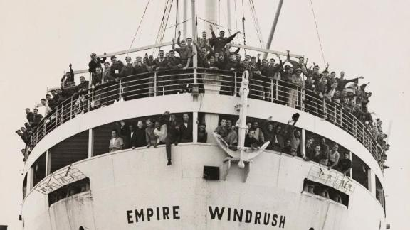 UNITED KINGDOM - JUNE 02:  The ?Windrush? arrives from Jamaica, 21 June 1948. A photograph of SS Empire Windrush docking at Tilbury, having sailed from Australia via Jamaica, with crowds of waving passengers, taken by Jones for the Daily Herald newspaper. During the war, thousands of men and women from the Carribbean were recruited to serve in the armed forces and aid the labour shortage in Britain. When Windrush stopped in Jamaica to pick up servicemen, many others, having seen the