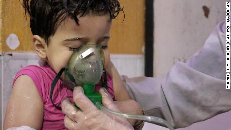 DAMASCUS, SYRIA - APRIL 08: An affected Syrian kid receives medical treatment after Assad regime forces allegedly conducted poisonous gas attack to Duma town of Eastern Ghouta in Damascus, Syria on April 08, 2018. At least 78 civilians dead, including women and children, according to the initial findings. (Photo by Mouneb Taim/Anadolu Agency/Getty Images)