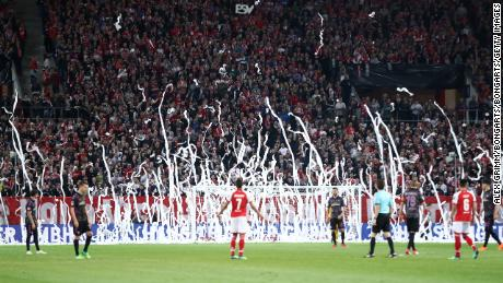 Mainz fans throw rolls of toilet paper onto the pitch to protest Monday night kickoffs.