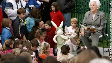 Former first lady and mother of President George W. Bush, Barbara Bush reads during the annual Easter Egg Roll at the White House on March 24, 2008 in Washington, DC.