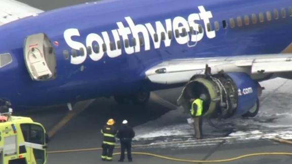 A window is missing from the plane as it sits on the tarmac Tuesday at the Philadelphia airport.