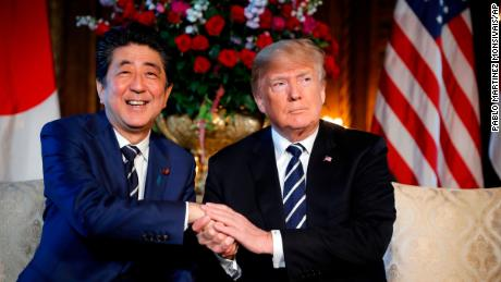 President Donald Trump and Japanese Prime Minister Shinzo Abe shake hands during their meeting at Trump's private Mar-a-Lago club, Tuesday, April 17, 2018, in Palm Beach, Fla. (AP Photo/Pablo Martinez Monsivais)