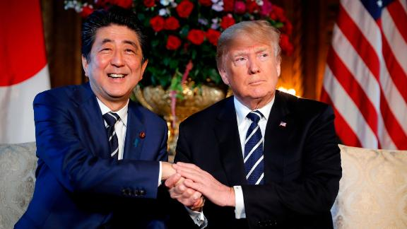 President Donald Trump and Japanese Prime Minister Shinzo Abe shake hands during their meeting at Trump's private Mar-a-Lago club, Tuesday, April 17, 2018, in Palm Beach, Fla.