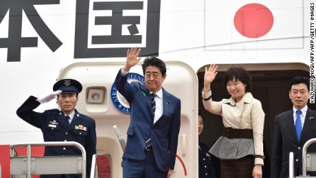 Japan's Prime Minister Shinzo Abe (2nd L) and his wife Akie wave as they prepare to depart from Tokyo's Haneda airport on April 17, 2018. US President Donald Trump hosts Japan's Shinzo Abe at his Mar-a-Lago resort on April 17, with both men under pressure to deliver something more than bonhomie and birdies. / AFP PHOTO / Kazuhiro NOGI        (Photo credit should read KAZUHIRO NOGI/AFP/Getty Images)