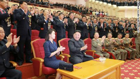 "This undated picture released by North Korea's official Korean Central News Agency (KCNA) on September 10, 2017 shows North Korean leader Kim Jong-Un (front C) and his wife Ri Sol-Ju (front 2nd L) attending an art performance dedicated to nuclear scientists and technicians, who worked on a hydrogen bomb which the regime claimed to have successfully tested, at the People's Theatre in Pyongyang. / AFP PHOTO / KCNA VIA KNS / STR / South Korea OUT / REPUBLIC OF KOREA OUT   ---EDITORS NOTE--- RESTRICTED TO EDITORIAL USE - MANDATORY CREDIT ""AFP PHOTO/KCNA VIA KNS"" - NO MARKETING NO ADVERTISING CAMPAIGNS - DISTRIBUTED AS A SERVICE TO CLIENTS THIS PICTURE WAS MADE AVAILABLE BY A THIRD PARTY. AFP CAN NOT INDEPENDENTLY VERIFY THE AUTHENTICITY, LOCATION, DATE AND CONTENT OF THIS IMAGE. THIS PHOTO IS DISTRIBUTED EXACTLY AS RECEIVED BY AFP.  /         (Photo credit should read STR/AFP/Getty Images)"