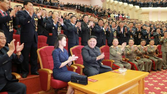 This photo from North Korean state media shows Kim and Ri attending an art performance in September 2017 dedicated to nuclear scientists and technicians, who worked on a hydrogen bomb which the regime claimed to have successfully tested, at the People