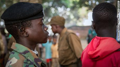 Freed child soldiers wait in a line for their registration during a release ceremony in Yambio, South Sudan.
