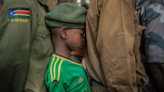 TOPSHOT - Newly released child soldiers wait in a line for their registration during the release ceremony in Yambio, South Sudan, on February 7, 2018. More than 300 child soldiers, including 87 girls, have been released in South Sudan's war-torn region of Yambio under a programme to help reintegrate them into society, the UN said on on Februar y 7, 2018. A conflict erupted in South Sudan little more than two years after gained independence from Sudan in 2011, causing tens of thousands of deaths and uprooting nearly four million people. The integration programme in Yambio, which is located in the south of the country, aims at helping 700 child soldiers return to normal life. / AFP PHOTO / Stefanie Glinski        (Photo credit should read STEFANIE GLINSKI/AFP/Getty Images)