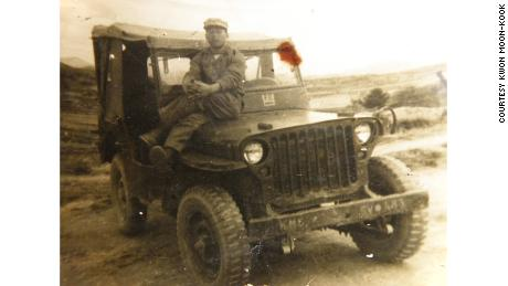 Kwon Moon-Kook is pictured sitting on a military vehicle around the time of the Korean War.