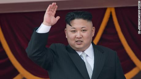 North Korean leader Kim Jong-Un waves from a balcony of the Grand People's Study house following a military parade in Pyongyang on April 15, 2017.