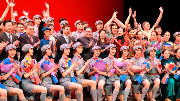 Kim and Ri pose alongside Chinese official Song Tao (left of Kim) on April 16, 2018 with members of a Chinese art troupe at the East Pyongyang Grand Theater in Pyongyang.