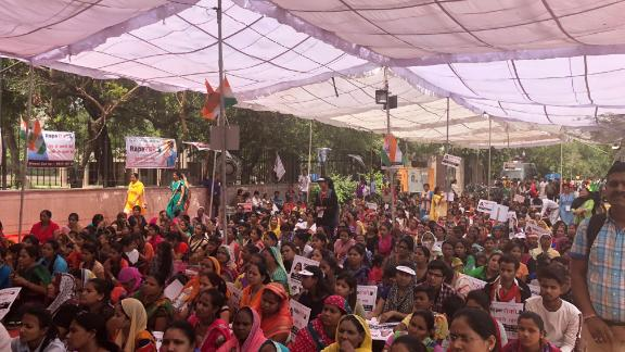 Hundreds of supporters attend a rally at the site of Maliwal